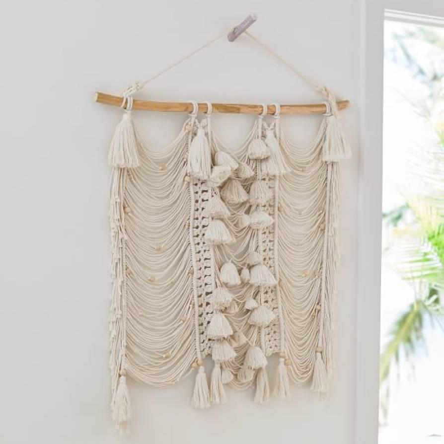 "Add unique texture to the bohemian grad's bedroom or living room with this handwoven wall hanging with tassels and wooden beads. $69, Pottery Barn Teen. <a href=""https://www.pbteen.com/products/bead-and-tassel-wall-hanging/"" rel=""nofollow noopener"" target=""_blank"" data-ylk=""slk:Get it now!"" class=""link rapid-noclick-resp"">Get it now!</a>"