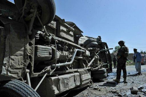 French soldiers at the scene where a civilian minibus was hit by a remote-controlled bomb in Paghman district of Kabul