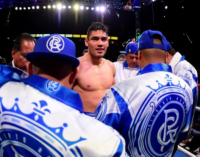 Mexican champion Gilberto Ramirez retained his WBO super middleweight title after challenger Habib Ahmed's corner threw in the towel in the sixth round (AFP Photo/Harry How)