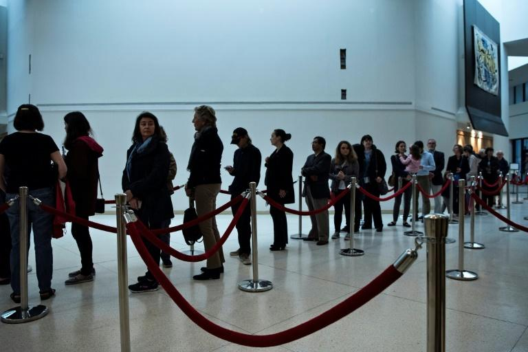 French citizens wait to vote in the country's presidential election at the Embassy of France on April 22, 2017 in Washington, DC