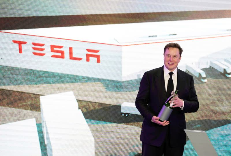 FILE PHOTO: FILE PHOTO: Tesla Inc CEO Elon Musk attends an opening ceremony for Tesla China-made Model Y program in Shanghai