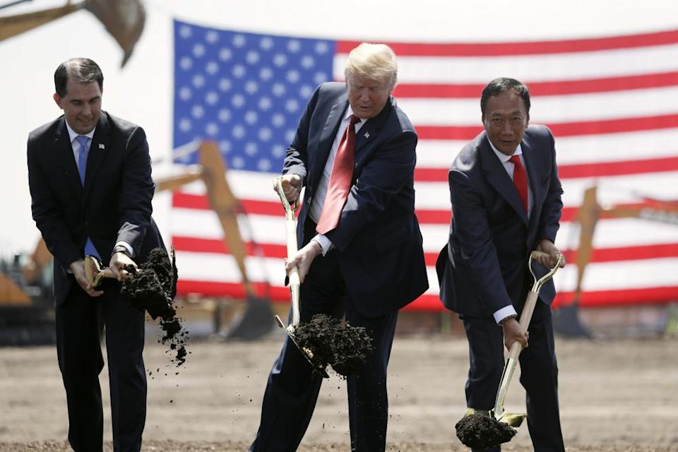 Trump in June 2018 breaks ground for a new Foxconn factory with then governor Scott Walker and Foxconn chairman Terry Gou.