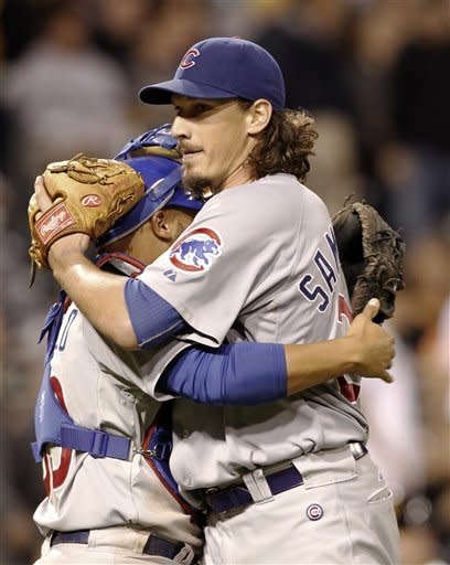 Chicago Cubs starting pitcher Jeff Samardzija, right, hugs catcher Welington Castillo after a baseball game against the Pittsburgh Pirates on Saturday, Sept. 8, 2012, in Pittsburgh. Samardzija threw a complete game as the Cubs beat the Pirates 4-3. AP Photo/Keith Srakocic)