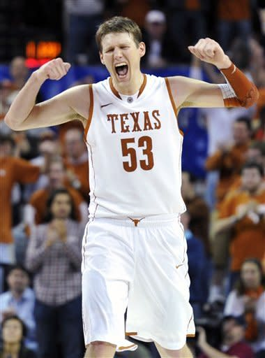 Texas center Clint Chapman reacts after a score against Missouri during the second half of an NCAA college basketball game, Monday, Jan. 30, 2012, in Austin, Texas. Missouri won 67-66. (AP Photo/Michael Thomas)