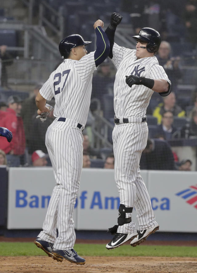 New York Yankees' Tyler Austin, right, celebrates with Giancarlo Stanton (27) after hitting a three-run home run against the Minnesota Twins during the third inning of a baseball game, Wednesday, April 25, 2018, in New York. (AP Photo/Julie Jacobson)