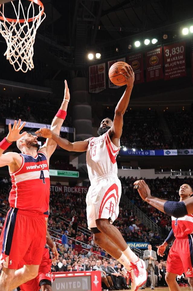 HOUSTON, TX - FEBRUARY 12: James Harden #13 of the Houston Rockets goes up for the dunk against the Washington Wizards on February 12, 2014 at the Toyota Center in Houston, Texas. (Photo by Bill Baptist/NBAE via Getty Images)