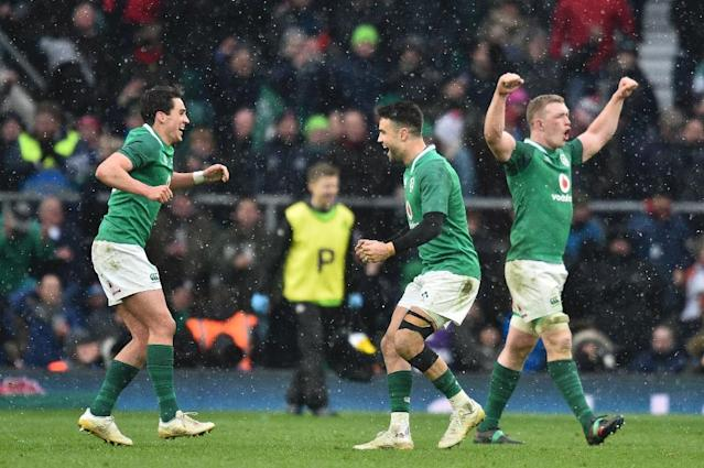 Ireland's Conor Murray (C) and Joey Carbery (L) celebrate their victory at the end of their Six Nations match against England at Twickenham (AFP Photo/Glyn KIRK )