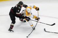 Nashville Predators' Viktor Arvidsson (33) and Arizona Coyotes' Jakob Chychrun (6) battle for the puck during first period NHL hockey action in Edmonton, Alberta, Friday, Aug. 7, 2020. (Jason Franson/The Canadian Press via AP)