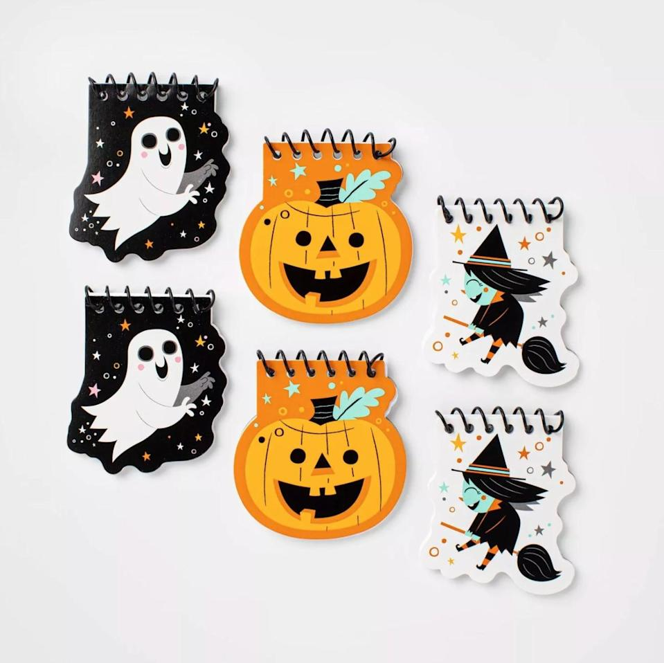 <p>Kids can jot down their inner most thoughts this All Hallow's Eve using these <span>Hyde & EEK! Boutique 6-Count of Halloween Spiral Notebooks</span> ($1).</p>