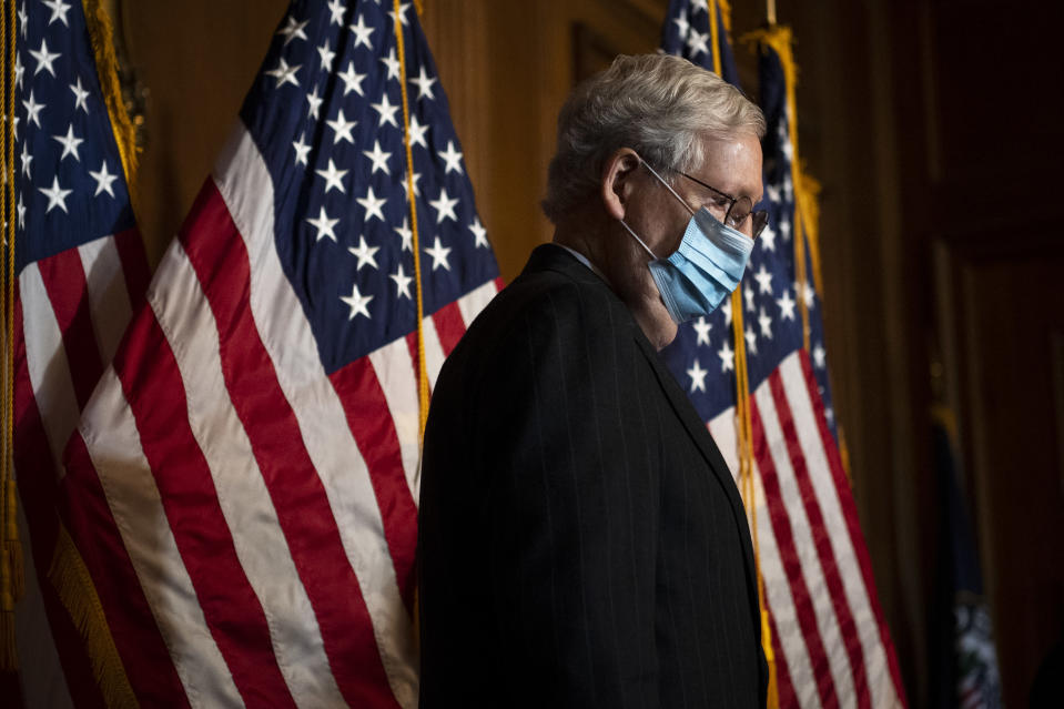 Senate Majority Leader Mitch McConnell of Ky., arrives for a news conference with other Senate Republicans on Capitol Hill in Washington, Tuesday, Dec. 15, 2020. (Caroline Brehman/Pool via AP)