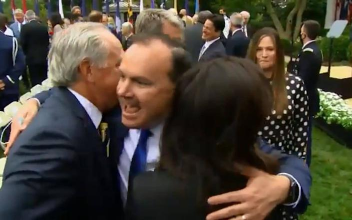 Senator Mike Lee, pictured hugging other attendees, has since tested positive - Matthew Fearn