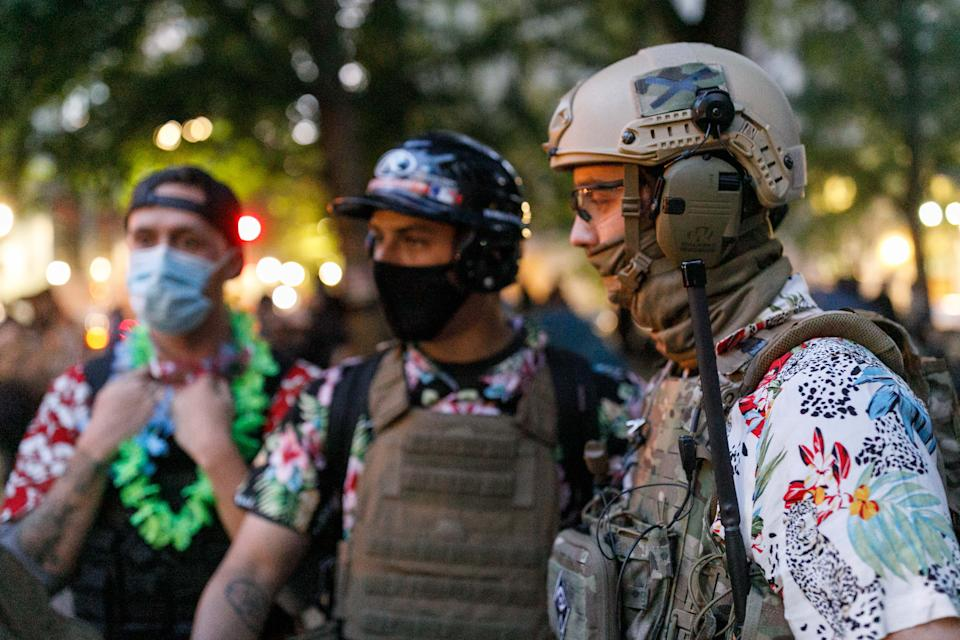 The 'Boogaloo Bois', an armed libertarian group, dress in their signature Hawaiian shirts during a protest on 24, 2020 in Portland, Oregon.  (John Rudoff/Anadolu Agency via Getty Images)