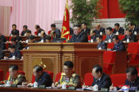 "In this photo provided by the North Korean government, North Korean leader Kim Jong Un, center, attends a ruling party congress in Pyongyang, North Korea Wednesday, Jan. 6, 2021. North Korea's ruling Workers' Party continued its landmark Congress for a second day Wednesday, state media reported early Thursday. Independent journalists were not given access to cover the event depicted in this image distributed by the North Korean government. The content of this image is as provided and cannot be independently verified. Korean language watermark on image as provided by source reads: ""KCNA"" which is the abbreviation for Korean Central News Agency. (Korean Central News Agency/Korea News Service via AP)"