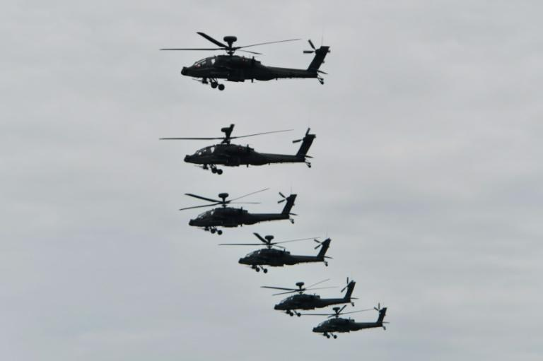 US-made AH-64E Apache attack helicopters fly in formation during the annual military drills in Taichung, Taiwan in July 2020