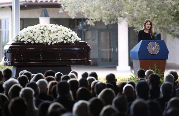 <p>Patti Davis, daughter of Ronald and Nancy Reagan, speaks at her mother's funeral at the Ronald Reagan Presidential Library. <i>(Photo: Lucy Nicholson/Reuters)</i></p>