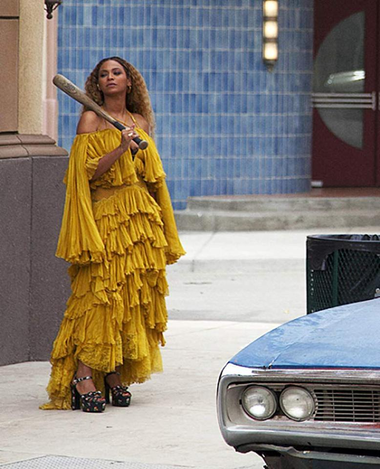 "<p>The now-iconic Roberto Cavalli off-the-shoulder yellow dress Beyoncé wore while smashing car windows in the ""Hold Up"" music video may be interpreted as a reference to the African goddess Oshun, the mother of fresh water who is historically depicted in yellow. Quite fittingly, the opening visual of the music video shows Beyoncé submerged in water. Later in the video, she emerges from a building in a flood of water, still wearing the layered yellow dress.</p>"