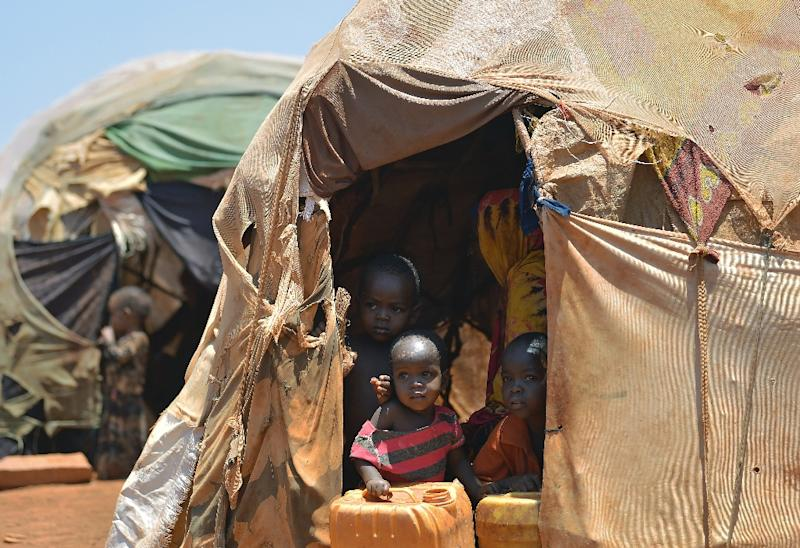 Internally displaced children pictured at the entrance of a hut at a makeshift camp on the outskirts of Baidoa, in the southwestern Bay region of Somalia, on March 14, 2017
