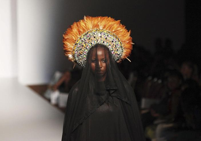 A model displays an outfit by designer Anita Quansah, during MTN Fashion and Design Week in Lagos, Nigeria, Thursday, Oct. 25, 2012. (AP Photo/Sunday Alamba)