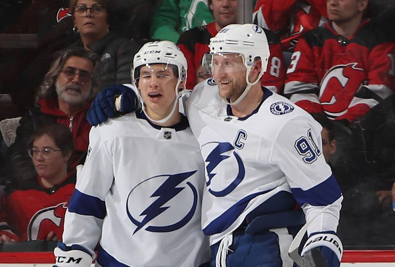 NEWARK, NEW JERSEY - DECEMBER 03: Yanni Gourde #37 of the Tampa Bay Lightning (l) celebrates his goal at 12:39 of the second period against the New Jersey Devils and is joined by Steven Stamkos #91 (r) at the Prudential Center on December 03, 2018 in Newark, New Jersey. (Photo by Bruce Bennett/Getty Images)