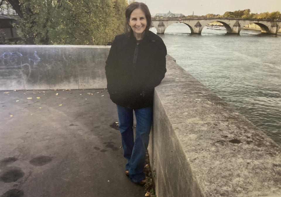 Associated Press journalist Sharon Cohen poses for a photo overlooking the Seine in Paris in 2019. Cohen, a matchless reporter who told American stories with great skill and compassion over more than four decades at The AP, died Monday, April 5, 2021, at her Chicago home. She was 68. (Courtesy of Mike Robinson)