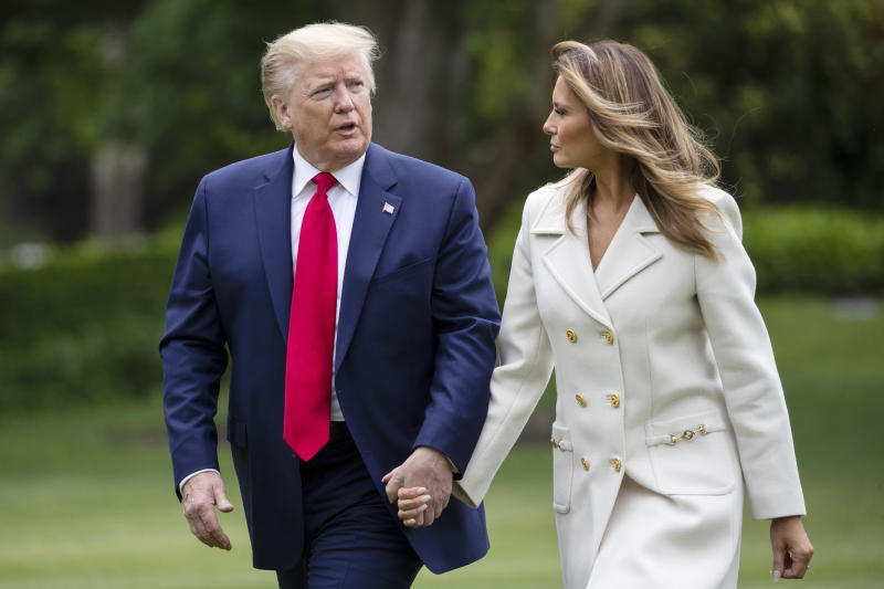 FILE - In this May 25, 2020 photo, President Donald Trump, accompanied by first lady Melania Trump, walks as they return on Marine One on the South Lawn of the White House in Washington, after returning from Fort McHenry National Monument and Historic Shrine, in Baltimore, for a Memorial Day ceremony. (AP Photo/Alex Brandon)