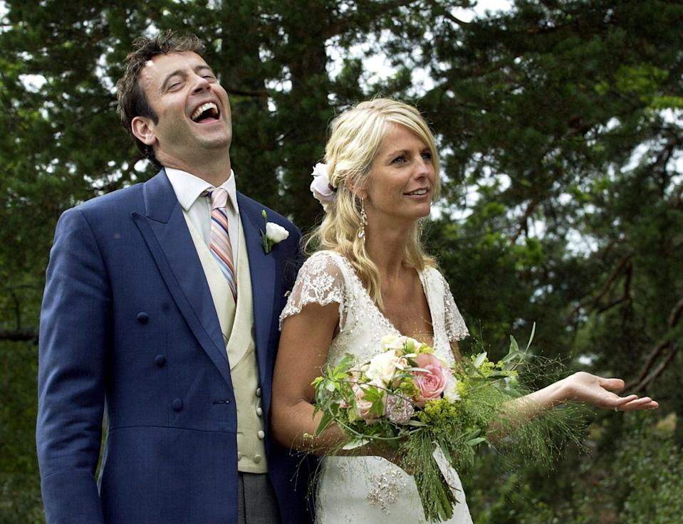 Ulrika Jonsson, right, and her British husband Lance Gerrard-Wright are seen during a photo call right after their wedding on the island of Varmdo in the Stockholm archipelago, Sweden, Saturday Aug.16 2003.  (AP Photo /Pressens Bild/Mark Earthy)  ** SWEDEN OUT **