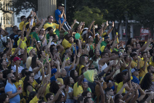Brazil soccer fan reacts as they watch a live telecast of their team's World Cup match against Switzerland at Maua square in Rio de Janeiro, Brazil, Sunday, June 17, 2018. The match ended in a draw 1-1. (AP Photo/Leo Correa)