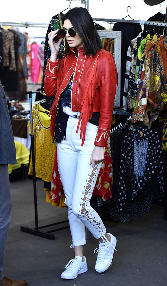 <p>Lace-up jeans are making their returnfrom the early aughts—but thankfully this time without the insanely low waistlines. Kendall Jenner makes the look work with a light-wash, high-waisted pair with lace detailing up the sides.</p>
