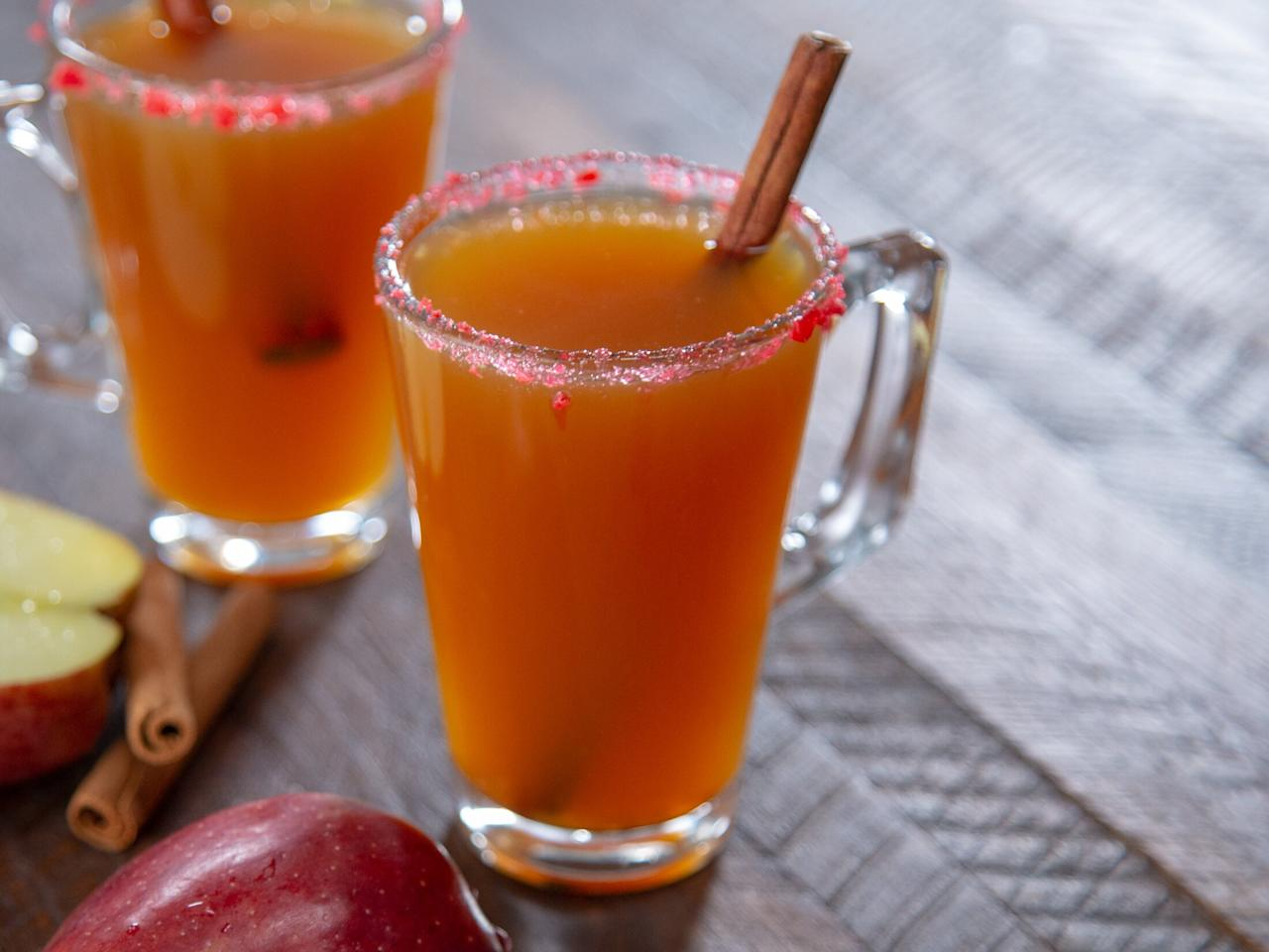 """<p>Mulled cider and cinnamon whiskey unite to create a perfect winter sipper. The Fireball flavor may be subtle here, but there's no doubt this cider is spiked. We prefer using refrigerated cider to shelf-stable cider. Depending on your preferred brand of cider, you may choose to omit the added sugar during the mulling step. This recipe makes 12 servings, but you don't have to serve it all at once. You can mull the cider, serve what you want, and save the remainder in the fridge.</p> <p><a href=""""https://www.myrecipes.com/recipe/cinnamon-hot-toddy"""">Cinnamon Hot Toddy Recipe</a></p>"""