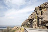 <p><strong>The Drive: </strong>Wichita Mountains Scenic Byway</p><p><strong>The Scene: </strong>Located in southwestern Oklahoma, the Wichita Mountains Scenic Byway offers some of the prettiest wildflower sightings in the spring, and amazing fall foliage views in the fall.</p><p><strong>The Pit-Stop: </strong>Climb Mt. Scott to get a panoramic view of the surrounding mountains.</p>