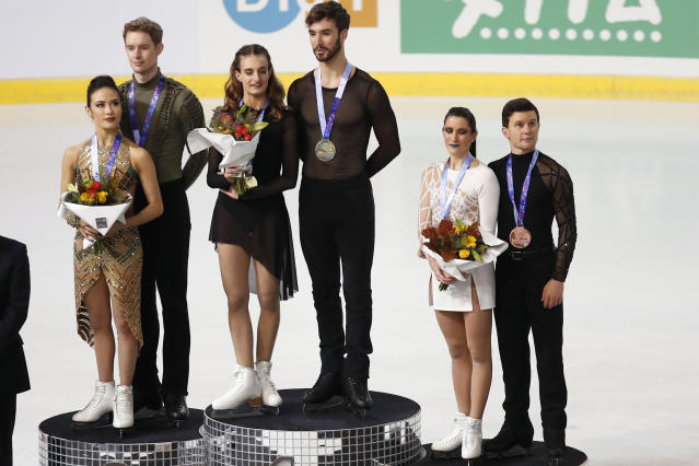 US' Madison Chock and Evan Bates Gabriella, with silver medal, Papadakis and Guillaume Cizeron of France with gold medal and Charlene Guignard and Marco Fabbri of Italy with bronze medal pose for the medal ceremony in the Ice Dance Free Dance during the ISU figure skating France's Trophy, in Grenoble, French Alps, France, Saturday, Nov. 2, 2019. (AP Photo/Francois Mori)