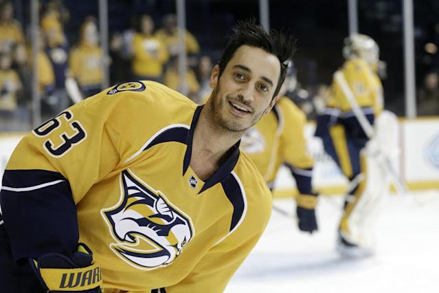 FILE - In this Jan. 13, 2015, file photo, Nashville Predators center Mike Ribeiro (63) warms up before an NHL hockey game against the Vancouver Canucks in Nashville, Tenn. The chance the Predators took in signing Ribeiro to a one-year deal after Arizona cut the center is paying off very well for everyone. (AP Photo/Mark Humphrey, File)