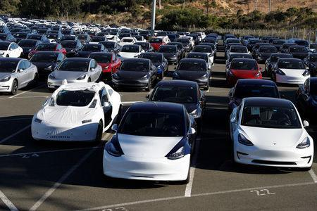 A parking lot of predominantly new Tesla Model 3 electric vehicles is seen in Richmond, California, U.S. June 22, 2018. Picture taken June 22, 2018. REUTERS/Stephen Lam