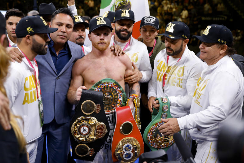 Canelo Alvarez, of Mexico, poses after his win against Daniel Jacobs in a middleweight title boxing match Saturday, May 4, 2019, in Las Vegas. (AP Photo/John Locher)