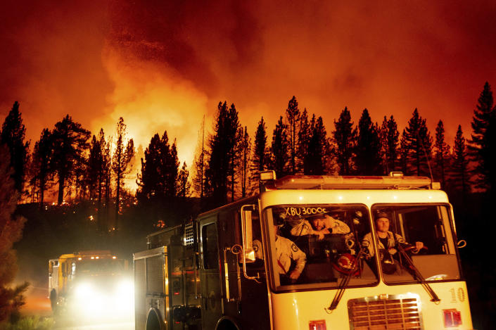 Firefighters arrive at Frenchman Lake to battle the Sugar Fire, part of the Beckwourth Complex Fire, burning in Plumas National Forest, Calif., on Thursday, July 8, 2021. (AP Photo/Noah Berger)