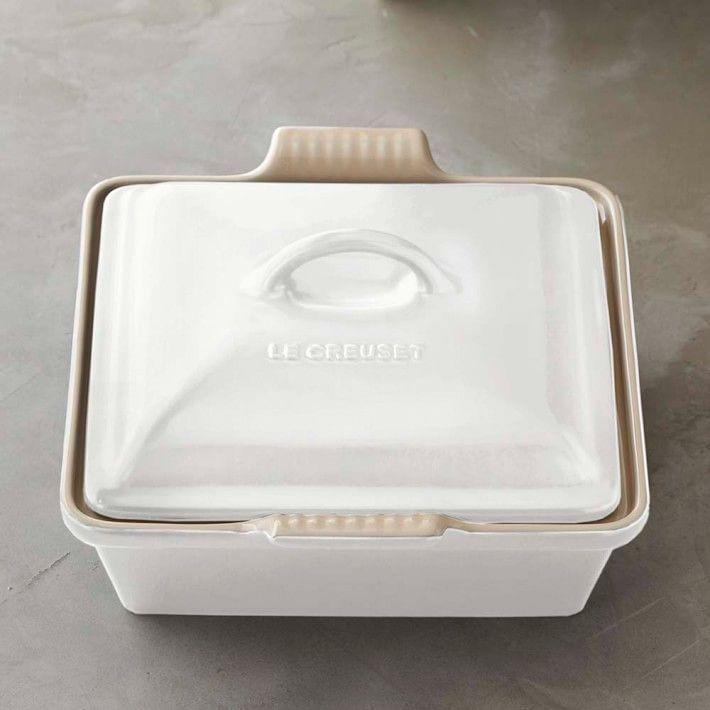 """<p><strong>Le Creuset </strong></p><p>williams-sonoma.com</p><p><strong>$60.00</strong></p><p><a href=""""https://go.redirectingat.com?id=74968X1596630&url=https%3A%2F%2Fwww.williams-sonoma.com%2Fproducts%2Fle-creuset-stoneware-shallow-square-covered-baker_8&sref=https%3A%2F%2Fwww.womansday.com%2Frelationships%2Fdating-marriage%2Fg36408636%2Fbridal-shower-gift-ideas%2F"""" rel=""""nofollow noopener"""" target=""""_blank"""" data-ylk=""""slk:Shop Now"""" class=""""link rapid-noclick-resp"""">Shop Now</a></p><p>Le Creuset cookware is built to last as long as the happiest of marriages. This piece in particular can be used to bake anything from pastries to macaroni and cheese.</p>"""