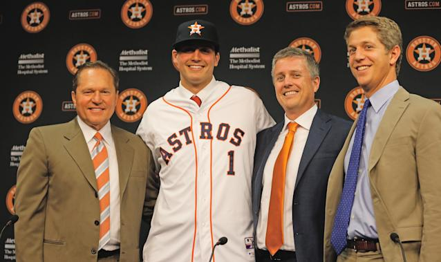 HOUSTON, TX - JUNE 19: (L-R) Agent Scott Boras, Mark Appel, general managerJeff Luhnow and director of amateur scouting Mike Elias pose for the media after the Houston Astros signed first overall draft pick Appel to the team prior to the start of the game between the Milwaukee Brewers and the Houston Astros at Minute Maid Park on June 19, 2013 in Houston, Texas. (Photo by Scott Halleran/Getty Images)