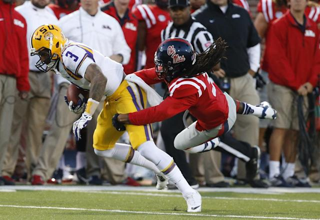 LSU wide receiver Odell Beckham Jr. (3) is tackled by Mississippi defensive back Charles Sawyer (3) in the first half of a NCAA college football game in Oxford, Miss., Saturday, Oct. 19, 2013. (AP Photo/Rogelio V. Solis)