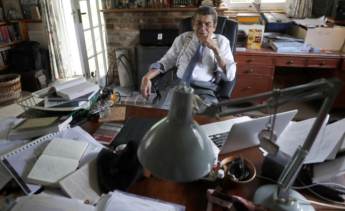 Human rights lawyer Geoffrey Nice sits at his desk at his home in Adisham, England, Wednesday, Sept. 2, 2020. The prominent British human rights lawyer is convening an independent tribunal in London with public hearings next year, to look into the Chinese government's alleged rights abuses against the Uighur Muslim minority in the far western province of Xinjiang.(AP Photo/Frank Augstein)