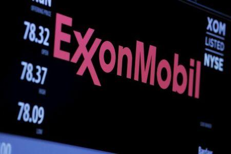 The logo of Exxon Mobil Corporation is shown on a monitor above the floor of the New York Stock Exchange in New York