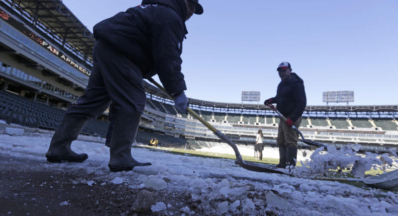 This Monday, March 17, 2014 photo taken in Chicago, shows U.S. Cellular Field, home to the Chicago White Sox baseball team, as members of head groundskeeper Roger Bossard's crew work to ready the field for opening day after one of the most brutal winters the city has ever seen. Brossard described the unusual conditions including 30 inches of permafrost, and having to remove 400 tons of snow from the playing field, as the perfect storm. (AP Photo/M. Spencer Green)