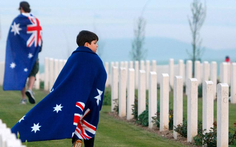 People walk after the wreath-laying ceremonies at the Australian National Memorial in Villers-Bretonneux, northern France on Anzac Day in 2011 - AP