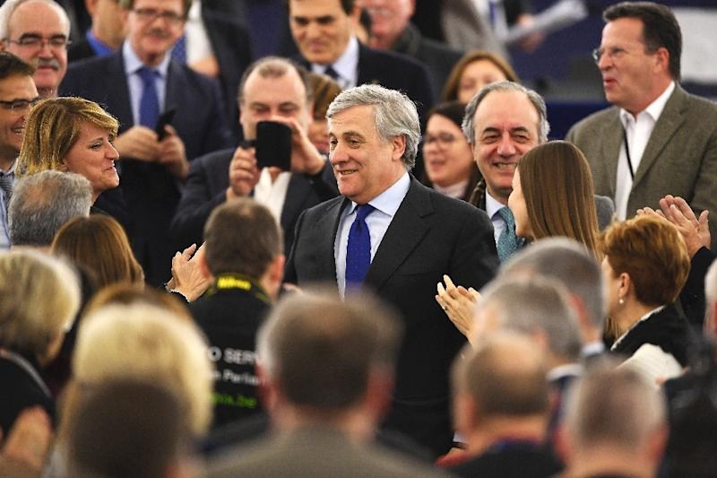 The European Parliament's new President Antonio Tajani (C) is congratulate by members of European Parliament following his election in Strasbourg, eastern France, on January 17, 2017 (AFP Photo/FREDERICK FLORIN)