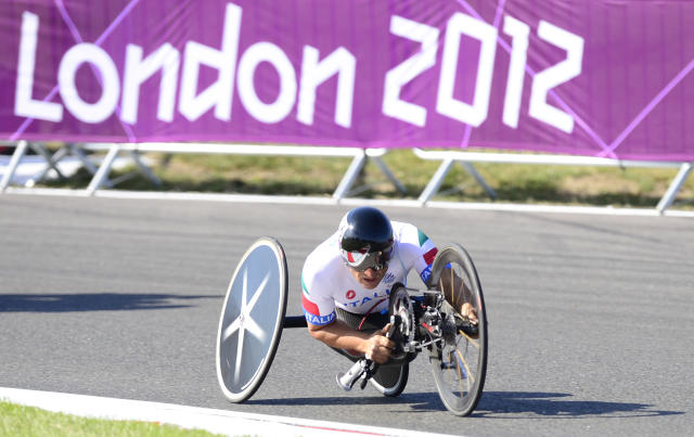 Italy's Alessandro Zanardi heads to victory in the men's individual H4 time trial cycling final during the London 2012 Paralympic Games at Brands Hatch circuit, in Kent, southern England on September 5, 2012. AFP PHOTO / LEON NEALLEON NEAL/AFP/GettyImages