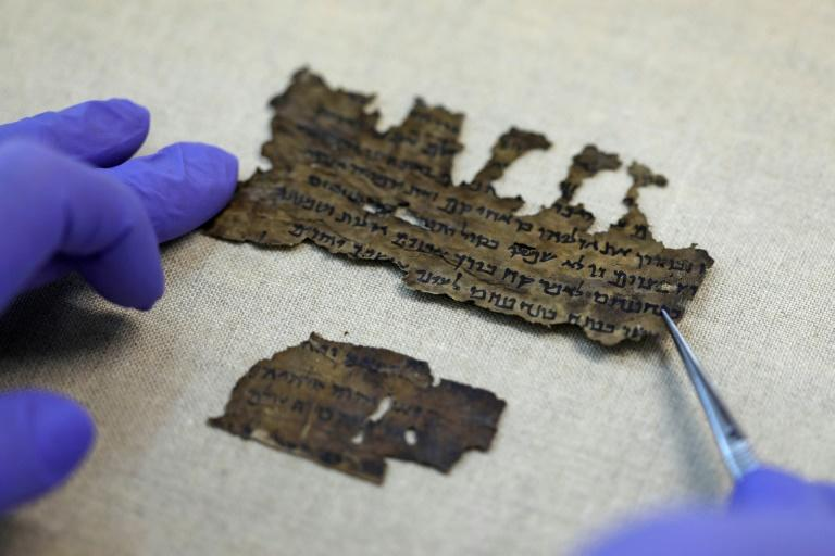 The parchment and papyrus Dead Sea Scrolls contain Hebrew, Greek and Aramaic and include some of the earliest-known texts from the Bible, including the oldest surviving copy of the Ten Commandments (AFP Photo/MENAHEM KAHANA)