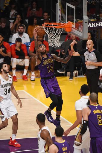 LOS ANGELES, CA - DECEMBER 21: Brandon Ingram #14 of the Los Angeles Lakers drives to the basket during the game against the New Orleans Pelicans on December 21, 2018 at STAPLES Center in Los Angeles, California. (Photo by Adam Pantozzi/NBAE via Getty Images)
