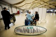 Passengers get tested for COVID-19 at Ben Gurion international airport