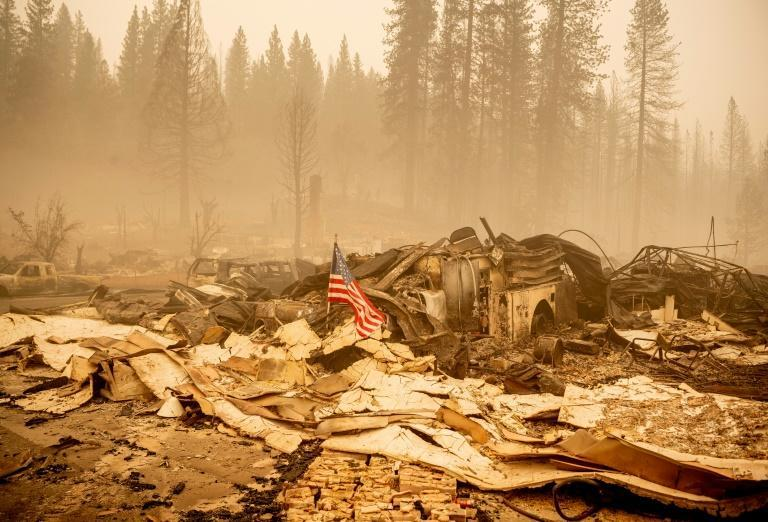 An American flag is placed at a burned fire station in downtown Greenville, California
