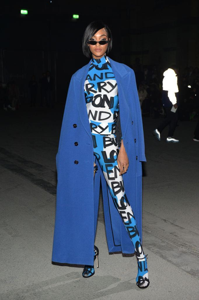 <p>Model Jourdan Dunn donned a cobalt blue take on the trench with Matrix-inspired sunnies. <em>[Photo: Getty]</em> </p>