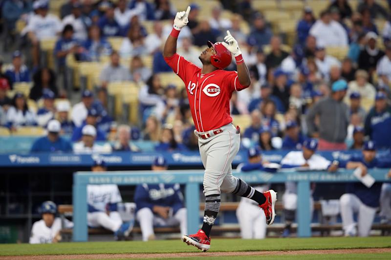 LOS ANGELES, CA - APRIL 15: Yasiel Puig # 42 of the Cincinnati Reds reacts after hitting a home run in the first inning during the game between the Cincinnati Reds and the Los Angeles Dodgers at Dodgers Stadium on Monday the 15th April 2019 in Los Angeles, california. (Photo by Rob Leiter / MLB photos via Getty Images)